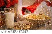 Купить «Video composition with falling snow over desk with cookies, Santa hat, and milk glass», видеоролик № 29497627, снято 13 декабря 2018 г. (c) Wavebreak Media / Фотобанк Лори