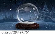 Купить «Video composition with snow over winter scenery with glass ball», видеоролик № 29497751, снято 13 декабря 2018 г. (c) Wavebreak Media / Фотобанк Лори