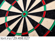 Купить «Hitting in the target center of dartboard. Targeting the business concept. Bullseye of a Dartboard», фото № 29498027, снято 28 ноября 2018 г. (c) Евгений Глазунов / Фотобанк Лори