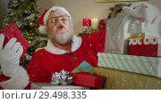 Купить «Video composition with falling snow over santa  at desk with gifts», видеоролик № 29498335, снято 30 ноября 2018 г. (c) Wavebreak Media / Фотобанк Лори