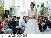 Купить «Noemi Vallone show during the Madrid Bridal Week at Palacio de Cibeles, Spain. Featuring: Model on catwalk Where: Madrid, Spain When: 19 Apr 2018 Credit: Oscar Gonzalez/WENN.com», фото № 29500899, снято 19 апреля 2018 г. (c) age Fotostock / Фотобанк Лори