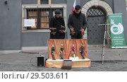 Купить «POLAND, WARSAW 9-11-2018: Performance. Puppets plays instruments on the little stage. People control the marionettes», видеоролик № 29503611, снято 6 декабря 2019 г. (c) Константин Шишкин / Фотобанк Лори