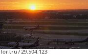 Купить «Terminal D with planes at Sheremetyevo Airport in Moscow, Russia. View at sunset», видеоролик № 29504123, снято 7 августа 2017 г. (c) Данил Руденко / Фотобанк Лори
