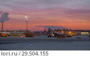 Купить «Area of Sheremetyevo Airport with planes and vehicles at the dawn in winter», видеоролик № 29504155, снято 11 ноября 2017 г. (c) Данил Руденко / Фотобанк Лори