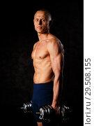 Купить «Handsome, muscular man with dumbbell. Strength and motivation», фото № 29508155, снято 29 октября 2018 г. (c) Иван Карпов / Фотобанк Лори