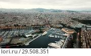 Купить «View from drones of sailboats and yachts in old port of Barcelona and gothic quarter at night», видеоролик № 29508351, снято 28 сентября 2018 г. (c) Яков Филимонов / Фотобанк Лори