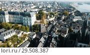 Купить «View from drone of French city of Blois with Royal Chateau and church of St. Nicolas in sunny autumn day», видеоролик № 29508387, снято 25 октября 2018 г. (c) Яков Филимонов / Фотобанк Лори
