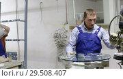Купить «woman and her male colleague working at glass factory», видеоролик № 29508407, снято 16 октября 2018 г. (c) Яков Филимонов / Фотобанк Лори