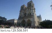 Купить «View of impressive Cathedral of Our Lady (Notre-Dame) against blue autumn sky», видеоролик № 29508591, снято 10 октября 2018 г. (c) Яков Филимонов / Фотобанк Лори