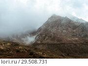 Купить «Moody gray gloomy mountain landscape with a rocky ridge among the clouds», фото № 29508731, снято 23 сентября 2017 г. (c) Евгений Харитонов / Фотобанк Лори