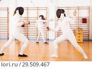 Купить «female athletes practicing movements at fencing battle», фото № 29509467, снято 11 июля 2018 г. (c) Яков Филимонов / Фотобанк Лори