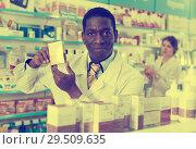 Купить «African American male pharmaceutist offering medicines drug», фото № 29509635, снято 2 марта 2018 г. (c) Яков Филимонов / Фотобанк Лори