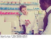 Купить «Female pharmacist giving cosmetics to adult male customer in pharmacy», фото № 29509651, снято 2 марта 2018 г. (c) Яков Филимонов / Фотобанк Лори