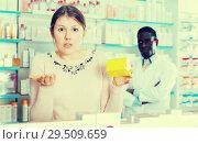 Купить «surprised by prices woman holding medicine», фото № 29509659, снято 2 марта 2018 г. (c) Яков Филимонов / Фотобанк Лори