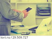 Male testing modern middle size touchpad. Стоковое фото, фотограф Яков Филимонов / Фотобанк Лори