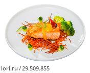 Купить «Steak of fried salmon with smoked carrots, broccoli, cucumbers and fig on plate», фото № 29509855, снято 14 октября 2019 г. (c) Яков Филимонов / Фотобанк Лори