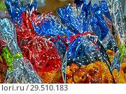 Купить «Праздничная упаковка подарков, прозрачная разноцветная упаковочная пленка», фото № 29510183, снято 1 декабря 2012 г. (c) FMRU / Фотобанк Лори