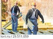 Купить «construction workers at building area installing wormwork», фото № 29511059, снято 12 октября 2018 г. (c) Дмитрий Калиновский / Фотобанк Лори
