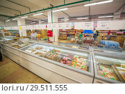 Russia, Samara, November 2018: interior of a grocery store with shop windows and freezers. Text in Russian: milk, fruit, vegetables. Редакционное фото, фотограф Акиньшин Владимир / Фотобанк Лори