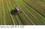 Купить «Aerial drone shot of a combine harvester working in a field at sunset. Tracking the subject in the center of the frame», видеоролик № 29511723, снято 16 сентября 2018 г. (c) Андрей Радченко / Фотобанк Лори