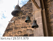 Купить «Three bells on the belfry of Church of the Dormition, Vardzia, Georgia», фото № 29511979, снято 25 сентября 2018 г. (c) Юлия Бабкина / Фотобанк Лори