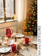 Купить «table served for christmas dinner at home», фото № 29512083, снято 14 декабря 2017 г. (c) Syda Productions / Фотобанк Лори