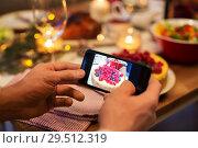 Купить «hands photographing food at christmas dinner», фото № 29512319, снято 17 декабря 2017 г. (c) Syda Productions / Фотобанк Лори
