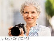 Купить «senior woman photographing by digital camera», фото № 29512443, снято 3 августа 2018 г. (c) Syda Productions / Фотобанк Лори