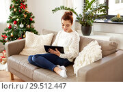 Купить «woman with tablet pc at home on christmas», фото № 29512447, снято 29 августа 2018 г. (c) Syda Productions / Фотобанк Лори