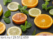 Купить «close up of grapefruit, orange, pomelo and lime», фото № 29512659, снято 4 апреля 2018 г. (c) Syda Productions / Фотобанк Лори
