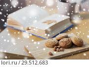 Купить «oatmeal cookies, almonds and book on table at home», фото № 29512683, снято 15 ноября 2017 г. (c) Syda Productions / Фотобанк Лори