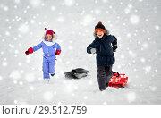 Купить «happy kids with sled having fun outdoors in winter», фото № 29512759, снято 10 февраля 2018 г. (c) Syda Productions / Фотобанк Лори