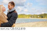 Купить «happy couple hugging over autumn beach», фото № 29512819, снято 5 октября 2013 г. (c) Syda Productions / Фотобанк Лори