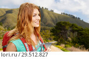 Купить «smiling woman with backpack on big sur hills», фото № 29512827, снято 25 июля 2015 г. (c) Syda Productions / Фотобанк Лори