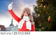 Купить «woman taking selfie over christmas tree», фото № 29512843, снято 7 января 2017 г. (c) Syda Productions / Фотобанк Лори