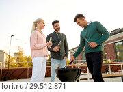 Купить «happy friends having bbq party on rooftop», фото № 29512871, снято 2 сентября 2018 г. (c) Syda Productions / Фотобанк Лори