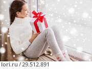 Купить «girl with christmas gift sitting on sill at window», фото № 29512891, снято 5 ноября 2016 г. (c) Syda Productions / Фотобанк Лори