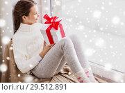 Купить «girl with christmas gift sitting on sill at window», фото № 29512891, снято 5 ноября 2016 г. (c) Syda Productions / Фотобанк Лори
