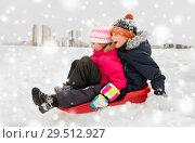 Купить «little kids sliding on sled down hill in winter», фото № 29512927, снято 10 февраля 2018 г. (c) Syda Productions / Фотобанк Лори