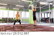 Купить «man and woman with weights exercising in gym», фото № 29512987, снято 19 февраля 2017 г. (c) Syda Productions / Фотобанк Лори