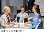 Купить «business team working at night office», фото № 29513047, снято 6 декабря 2017 г. (c) Syda Productions / Фотобанк Лори