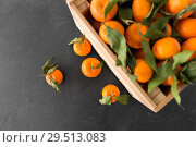 Купить «close up of mandarins on slate table top», фото № 29513083, снято 4 апреля 2018 г. (c) Syda Productions / Фотобанк Лори