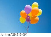 Купить «close up of colorful helium balloons in blue sky», фото № 29513091, снято 29 мая 2018 г. (c) Syda Productions / Фотобанк Лори