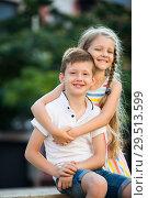 Купить «girl and boy embracing», фото № 29513599, снято 26 июня 2019 г. (c) Яков Филимонов / Фотобанк Лори