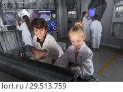 Купить «Children playing in bunker questroom», фото № 29513759, снято 21 октября 2017 г. (c) Яков Филимонов / Фотобанк Лори