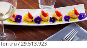 Купить «Ceviche of marinated salmon with kiwi, kumquat, figs», фото № 29513923, снято 16 июля 2019 г. (c) Яков Филимонов / Фотобанк Лори
