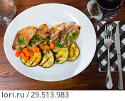 Купить «Mutton chops served with grilled vegetables», фото № 29513983, снято 4 июля 2020 г. (c) Яков Филимонов / Фотобанк Лори