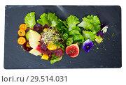 Купить «Image of delicious salad of raw tuna, mango, avocado and herbs», фото № 29514031, снято 19 декабря 2018 г. (c) Яков Филимонов / Фотобанк Лори