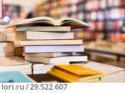 Купить «different books lying on table in library», фото № 29522607, снято 22 февраля 2018 г. (c) Татьяна Яцевич / Фотобанк Лори