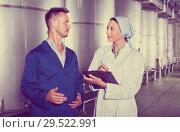 Купить «Portrait of two experts standing with clipboard in wine processing section», фото № 29522991, снято 19 января 2019 г. (c) Яков Филимонов / Фотобанк Лори